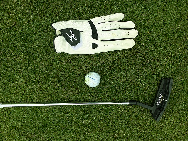 Golf - glove, ball, club on the course
